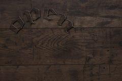 与题字的一个木标志 免版税库存照片