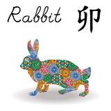 与颜色几何花的中国黄道带标志兔子 库存照片