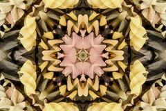 与颜色美丽的装饰物的万花筒  库存照片