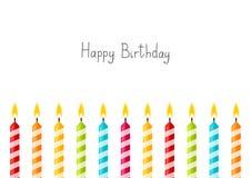 与颜色蜡烛的生日背景 免版税库存照片