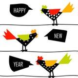 与颜色雄鸡的农历新年卡片在导线 免版税库存图片