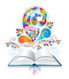 与颜色飞溅和卷毛的开放书。 免版税图库摄影
