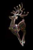 与风格化抽象多色彩的鹿的卡片在黑背景 免版税库存图片