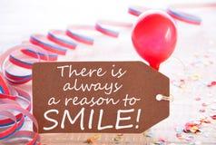 与飘带,气球的党标签,总是引述原因微笑 免版税库存照片