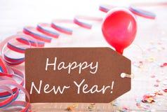 与飘带,气球,文本新年快乐的党标签 库存图片