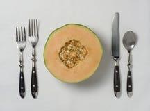 与餐位餐具的新鲜的Canteloupe 免版税库存照片