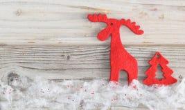 与马鹿的圣诞节背景 免版税图库摄影