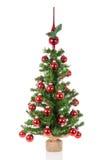 与高峰球的装饰的圣诞树在白色背景 免版税库存照片