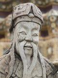 与髭的老中国人雕象 免版税库存图片