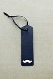 与髭的黑空白的礼物标记 免版税库存照片