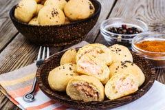 与鱼和chia种子的小蛋糕 库存照片
