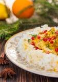 与鱼的米在圣诞节或新年晚餐的橙色调味汁 库存照片