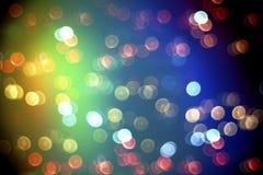 与鲜绿色的光线影响的Bokeh对迷离颜色背景 免版税库存照片