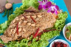 与鲶鱼菜单的泰国辣沙拉 免版税库存图片