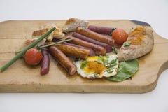 与鸡和香肠的早餐 图库摄影