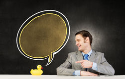 与鸭子的商人 图库摄影