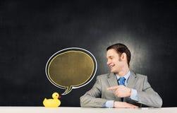 与鸭子的商人 免版税库存图片
