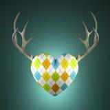 与鹿角的菱形心脏 库存照片