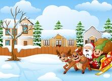 与鹿骑马的动画片圣诞老人在与袋子的一个雪橇礼物 库存照片