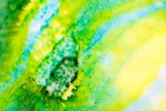 与黄色和绿色的水彩 免版税库存照片