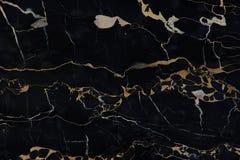 与黄色条纹的自然石头尼罗Portoro黑色 免版税图库摄影