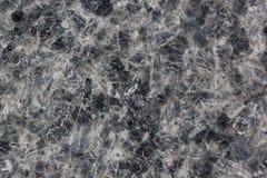 与黑和灰色斑点的淡色的花岗岩纹理 使用作为背景 免版税库存照片