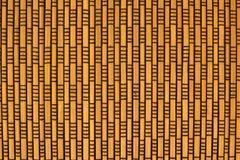 与黑螺纹的竹席子纹理 库存照片