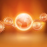 与齿轮传输和地球的抽象橙色背景 免版税库存图片
