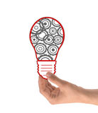 与齿轮和嵌齿轮的电灯泡 免版税图库摄影