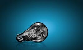 与齿轮的电灯泡 免版税图库摄影