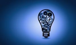 与齿轮的电灯泡 免版税库存照片