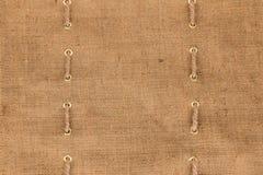 与绳索两条线的粗麻布  库存照片