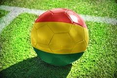 与玻利维亚的国旗的橄榄球球 图库摄影