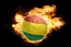 与玻利维亚的旗子的橄榄球球火的 图库摄影