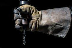 与钻子的手套 免版税库存照片
