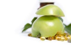 与医学瓶2的绿色苹果计算机 免版税库存图片