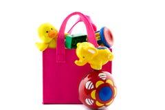 与婴孩玩具的袋子 库存照片