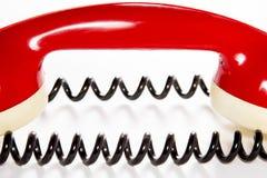 与导线的红色电话报告人 免版税库存图片
