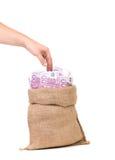 与货币袋子的现有量 库存照片