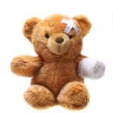 与绷带的经典玩具熊 库存照片