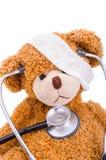 与绷带/医生的玩具熊 库存照片