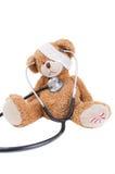 与绷带/医生的玩具熊 免版税库存照片