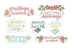 与7张假日卡片的汇集做了在圣诞节祝福上写字的手 爱,和平,喜悦 最快活的愿望 皇族释放例证