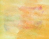 与水彩污点油漆艺术的橙黄,抽象背景资料纹理 免版税库存照片