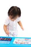 与水彩的亚洲矮小的中国女孩绘画 免版税库存照片