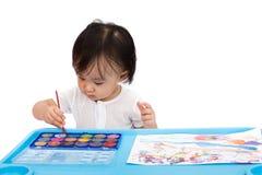 与水彩的亚洲矮小的中国女孩绘画 图库摄影