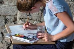 与水彩的女孩图画 免版税库存照片