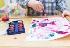 与水彩的小儿童绘画 库存照片