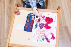与水彩的小儿童绘画 库存图片
