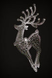 与幻想摘要苍白色的鹿的卡片在黑背景 库存图片